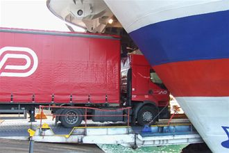 Freight lorry driving on board